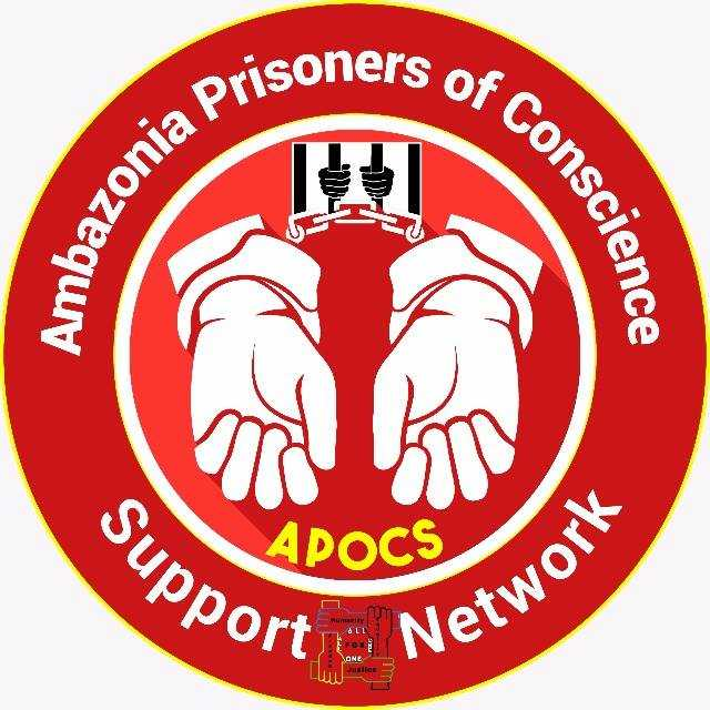 "A red circle. In the middle are two hands in handcuffs. Around the edge are the words ""Ambazonia Prisoners of Conscience Support Network"""