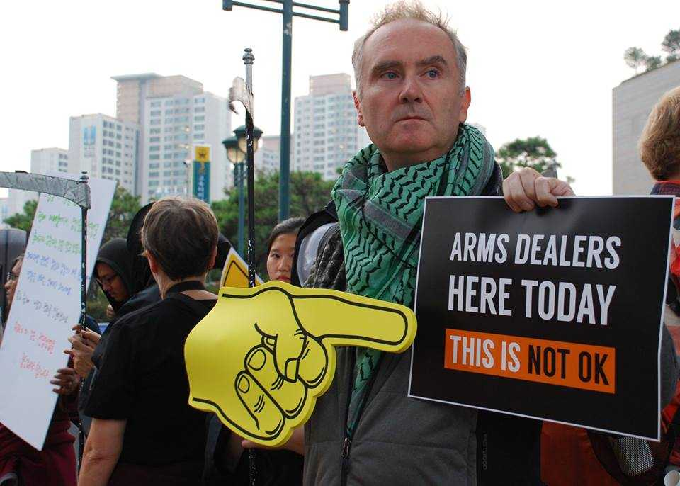 Activists outside the arms dealers' welcome dinner
