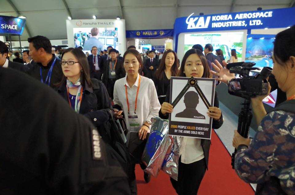 Activists removed by security at #ADEX
