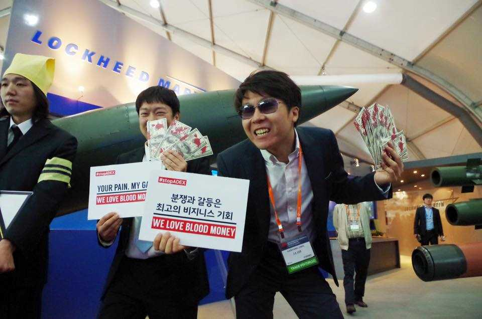 Activists from World Without War show #ADEX up for what it is: bloody money
