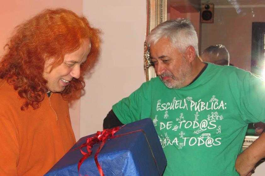 Photo: WRI. Howard presents Andreas with a gift at his leaving party, December 2012.