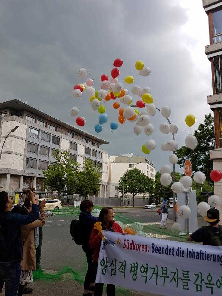 Balloons released at a International Conscientious Objectors Day protests