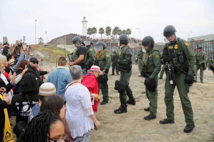At the Love Knows No Borders direct action organized by the American Friends Service Committee on December 10, 2018, faith leaders attempted to conduct a water ceremony calling for peace with justice to return to the land. U.S. Border Patrol agents prevented them from approaching the primary border wall and arrested 32 faith leaders.