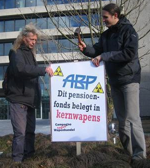 Two campaigners put up an anti-nuclear sign outside the APB offices in Netherlands