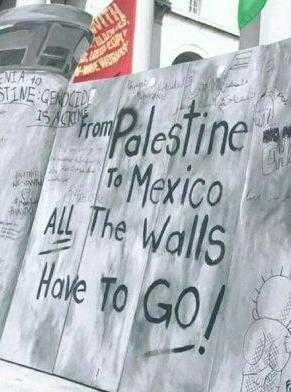 "A banner reading ""From Palestine to Mexico, all the walls have to go!"""