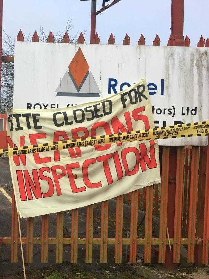 "A sign in front of the Roxel factory reads ""Closed for weapons inspection"""