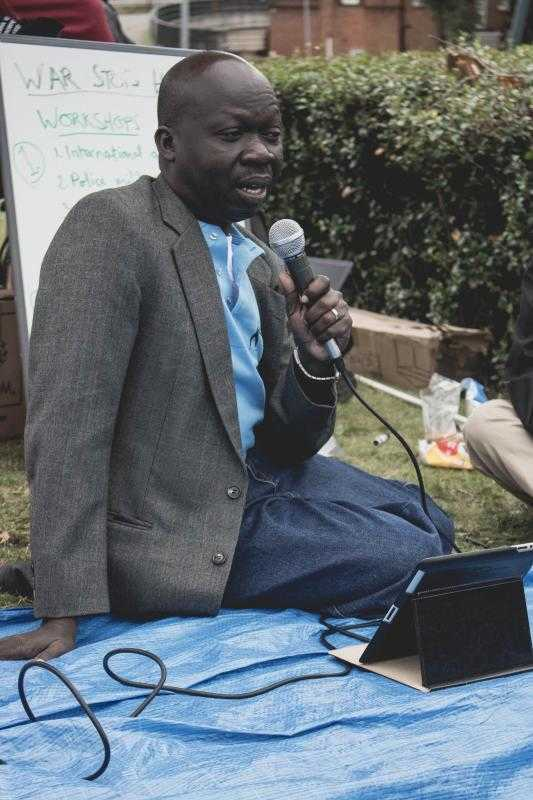 Moses John Monday speaking at the seminarabout armed violence in South Sudan