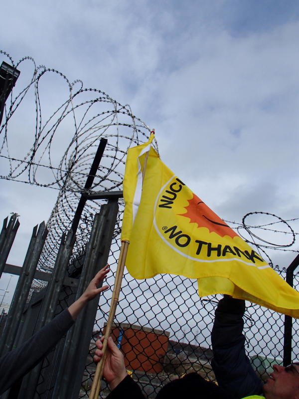 Yellow flag and barbed wire.  Photo credit / copyright: Marianne Birkby.