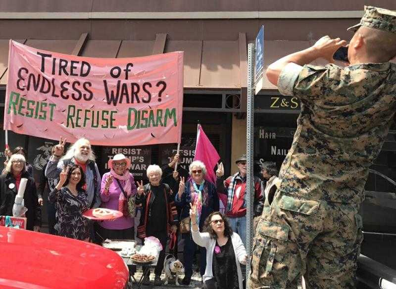 Activists in Berkley shut down a recruitment centre for CO day! Photo: Courage to Resist