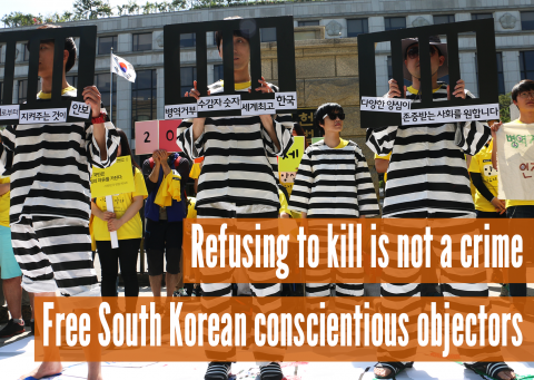 "South Korean activists protest wearing black and white ""jail"" uniforms"