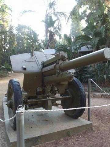 A decommissioned piece of artillery in a public park next to a playground (credit – Diana Dolev)