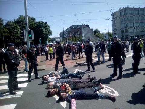 European Antimilitarist Network members blockading an entrance road to the NATO summit
