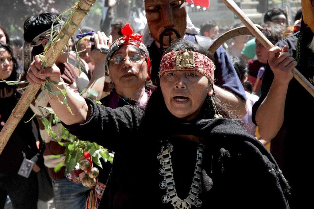 Several members of the Mapuche community taking part in a demonstration.