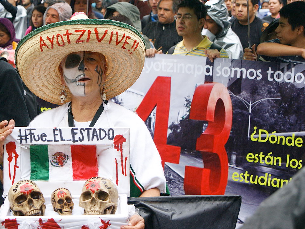 A woman with her face painted as a skeleton takes part in a protest in Mexico, remembering the 43 Mexican students killed
