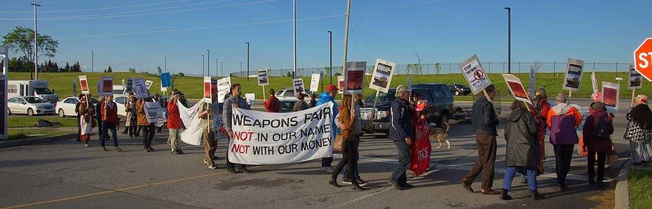Around 20 activists picket the CANSEC arms fair in Canada