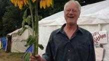 George Lakey holding sunflowers