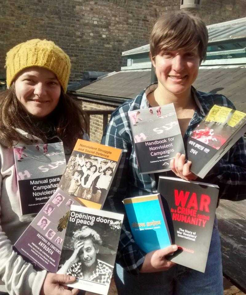 Hannah and Taya holding a selection of WRI books
