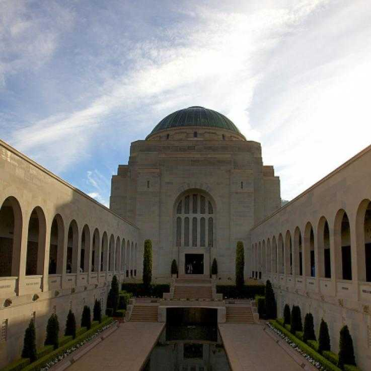 The Australian war memorial - a large stone building with arches and a central grass space