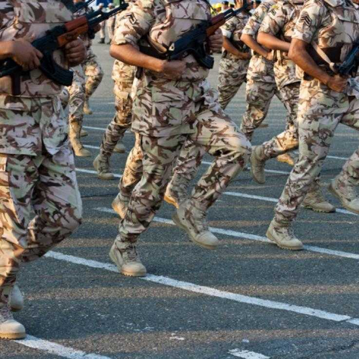 Saudi military personnel marching.
