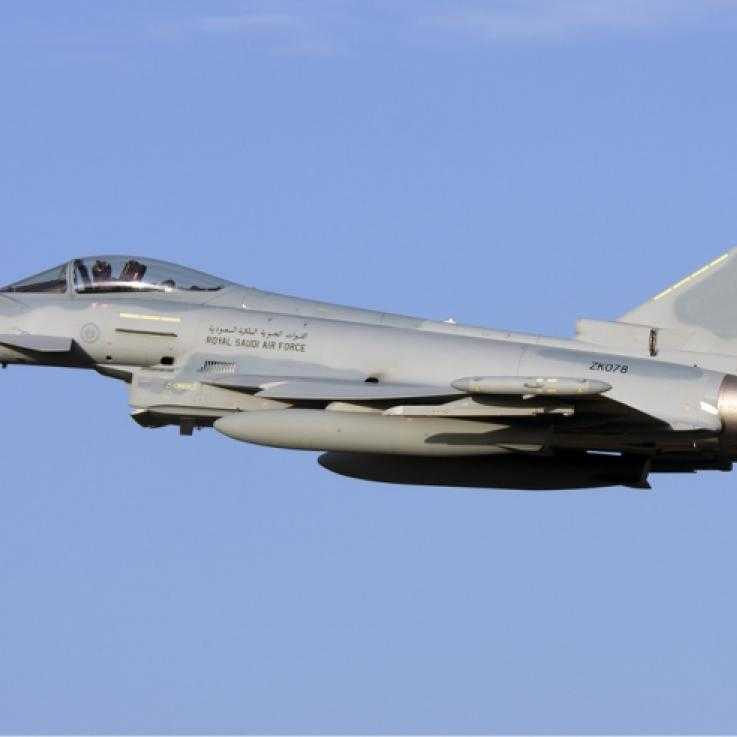 A eurofighter typhoon aircraft flying against a blue sky
