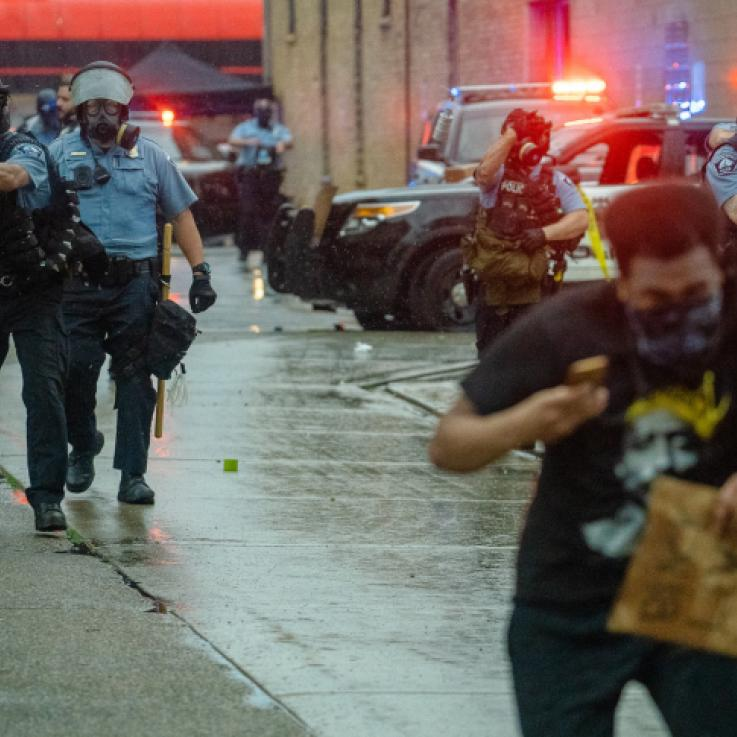 Minneapolis Police fire tear gas at those protesting the May 25th death of George Floyd.