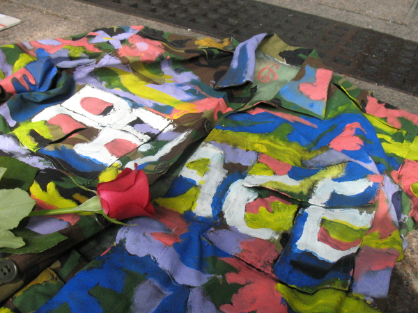 An army uniform painted by World Without War as part of a demonstration